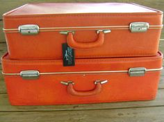 Two piece retro luggage set by Invicta. Yummy bright orange color with shiny silvertone trim and latches. Matching orange interior with ruffly pockets, and clear belts.