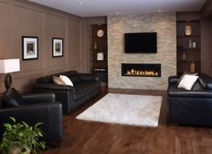 Best idea yet for Basement Fireplace! Do a stone wall, modern fireplace, mounted tv above fireplace and possibly the built-ins. - Decoration for House Living Room Tv Wall, Fireplace Design, Living Room Modern, Modern Room, Contemporary Family Rooms, Living Room Paint, New Living Room, Furniture Placement Living Room, Basement Fireplace