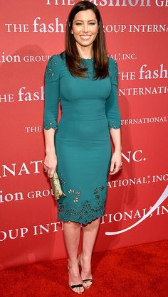 Jessica Biel in an emerald green Dolce & Gabbana lace cocktail dress