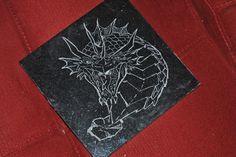 Dragon drawn by Dan Chapparo that I engraved on black granite tile.