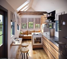 This is the Lodge Tiny House on Wheels by Modern Tiny Living. It's a beautiful tiny home and you're welcome to come check it out and learn more about it inside! Would you live in this tiny house design? Tyni House, Tiny House Cabin, Tiny House Living, Tiny House Plans, Tiny House On Wheels, Living Room, Tiny House Family, Tiny Home Floor Plans, Kitchen Living