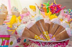 Ice cream cones stuffed with cotton candy shaped into ice cream, cone wrappers