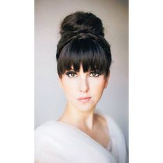 retro updo hairstyle with bangs