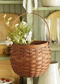 "This beautiful, functional Hanging Seasons Basket is great for flowers, magazines, mail or simply adding seasonal flair to your home. Hang on a door, a wall or display it on a table. 9 1/2""l x 5 1/8""w x 15""h (includes handle)"