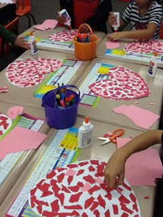 Easy classroom craft idea for teachers: Valentine's Day mosaic hearts using ripped paper and school glue.