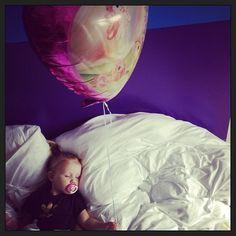 Lux sleeping with a balloon in her hand <3