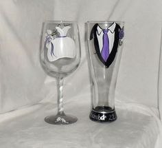 A unique gift for the Bride and Groom. Hand Painted Personalized Wine Glasses.  Features a gown and a tuxedo.  We can paint them in any colors you'd like and personalize them in any way that you'd like. These are shown in Black and White with Periwinkle accents.
