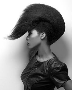 A long black straight textured sculptured hairstyle by Craig Chapman