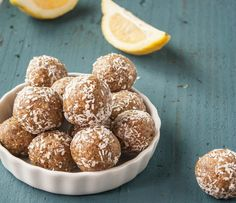 Lemon Poppyseed Bites    1 cup raw walnuts 1/2 cup raw sunflower seeds 1/2 cup unsweetened shredded coconut plus additional for rolling the balls 1 Tablespoon poppy seeds 1/2 teaspoon vanilla extract 1 cup medjool dates pitted  1-2 Tbsp lemon juice  1 teaspoon lemon zest Pinch of fine sea salt In a food processor blend the walnuts, sunflower seeds and coconut Add dates, lemon zest, lemon juice, vanilla extract, pinch of salt and poppy seeds.  Process until the mixture forms a rough dough
