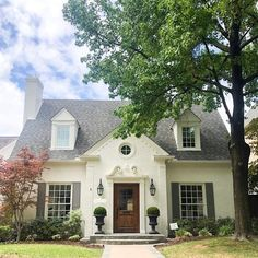 "I keep getting so many questions about what color we painted the exterior of this house. We used Sherwin Williams ""Creamy"" on the brick and Benjamin Moore ""Chelsea Gray"" on the shutters. I love the way it turned out! Swipe to see the before pic."