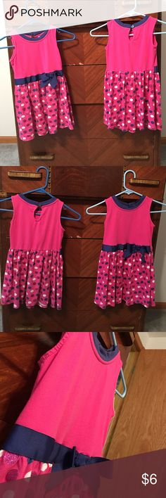 Girls sleeveless pink polkadot dress with bow 6/6X Girls cotton dresses both size 6/6X in dark pink with a blue ribbon and bow on waist line. White, blue, and pink glittered polka dots on skirt. In good used condition. Fabric is fading. 100% cotton Avon Dresses Casual