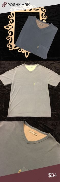 TED BAKER Basic Short Sleeve Pocket T Shirt This super soft Short Sleeve pocket t shirt by Ted Baker is the definition of luxe simplicity. This perfect shirt features the Ted Baker name across the back of the neck and on the front pocket. Pocket also secures with Velcro! Excellent used condition. Please note the color of the shirt is best represented by photo #1! 😊 Ted Baker Shirts Tees - Short Sleeve