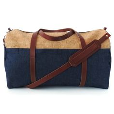 This genuine cork and denim bag can work for men and women. Perfect for road trips, weekend getaways, overnight trips! Use it as a carry-on or bring it with you to the gym! The cork is a great sustainable resource and is naturally water and stain resistant. Features include: - Made in USA eco-friendly denim - genuine leather straps that wrap around the bottom of the bag, for extra strength and support. Straps are the color of the leather shoulder strap. - two exterior zipped pockets that…