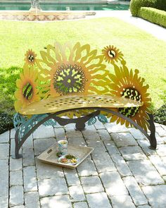 Sunflower Bench. A decorative, extravagant bench for the yard, porch or front step that features art, sunflowers and practicality. #sunflowerdecor #sunflower #gardenideas #afflnk