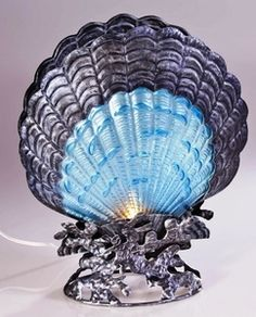 Glass and Metal Scallop Shell Lamp Beach that is a lovely tropical décor item. The shell curves are wavy like the beach and the blue color is definitely tropical. I would love to see this in a tropical décor. Tropical Style, Tropical Decor, Coastal Decor, Coastal Living, Tropical Furniture, Tropical Pool, Shell Lamp, Tropical Bathroom, Scallop Shells