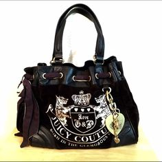 """Juicy Couture - """"Scottie Daydreamer"""" Velour Bag  Authentic Super Cute Velour Black Tote Bag! Gently used condition. In this beautiful bag, logo embroidery embellishes a soft velour tote trimmed in lightly textured leather. A beautiful drawstring top and a dangling gem-encrusted logo charm complete the look. It features magnetic-tab closure, an exterior slip pocket, interior zip, wall and cell phone pockets, detachable mimi-hand mirror, and logo-print lining.  Bundle discount is available…"""