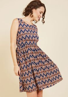 Colleague Karaoke A-Line Dress | Mod Retro Vintage Dresses | ModCloth.com  Celebrate the week's end by taking this chevron-printed dress out for a night of team building with your work pals! A leader both in the office and on stage, you leave your associates in awe with this frock's navy, petal, and orange hues - along with your savvy song styling and inclusive attitude!