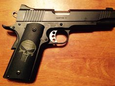 Kimber 1911 with Punisher grips.