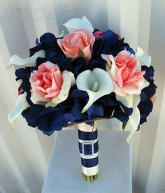 Today's inspiration focuses on the color palate navy and coral. This  combination is great way to portray a modern fall wedding. Coral was such a  big color for spring weddings but adding a hint of navy can bring out a  modern twist for fall weddings. Enjoy!  Décor- Shirvan Designs via Maharani Weddings  Dress – Via Pinterest  Bouquet- BrideinBloomWeddings  Photography- AndrenaPhotography  Table Setting- Via Pinterest