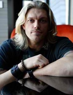 Adam Copeland (WWE Superstar Edge) He does not have blue eyes but they are still deep and dreamy. He's got the blonde hair going for him too :)