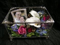 Preserved wedding flowers in a jewelry box.