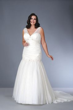 9326aa63cc7 We offer sleeveless plus size wedding dresses for brides all over the  globe. This v