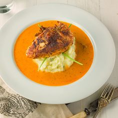 Chicken with creole cream sauce on a bed of green chili, garlic mashed potatoes. This dish takes a rustic cajun dish into fine dining territory.