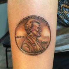 Forearm penny tattoo
