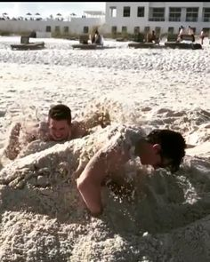 Shawn and Charlie on the beach and in the sand