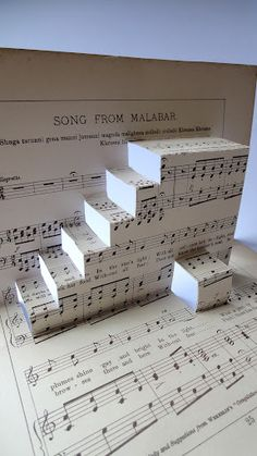 """A simple Pop-Up that is possible to make with children: the """"Jazz band"""" is a stair cut from an old score, you just follow the instructions drawn on the sheet of squared paper, and glue some blac…"""