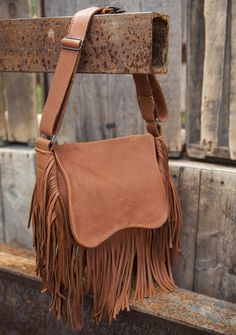 Made from buffalo hide leather, this saddle-style bag has a fold over closure, adjustable strap and of course the vintage fringe. Fringe Purse, Fringe Bags, Fringe Fashion, Saddle Bags, Buffalo, Handbags, Purses, Backpacks