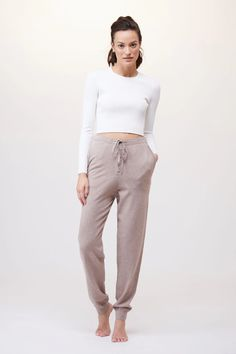 A modern interpretation of classic activewear essentials, from leggings to bodysuits to bras. Grey Pants, Wide Leg Pants, Slouchy Outfit, Mt Design, Matching Sweaters, Loungewear Set, Knit Tie, Long Johns, Polished Look