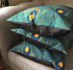 Cushion/Pillow Covers in an African wax cotton print which resembles peacock feathers , backed in a black cotton with envelope opening measurements 18 X 18 Washing Instructions Machine wash with warm water and mild soap. Avoid the spin cycle Hang to dry Iron on the wrong