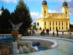 Colorful historical buildings combined with modern spaces with lots of green and light - that's what captured us the most in Debrecen. City Of Heroes, Big Country, Train Tickets, Fun To Be One, Hungary, Budapest, Wander, Countryside, Europe