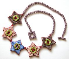 Nita E Kaufman-2 sided peyote stars with offset right-angle weave rope (my invention) & peyote closures.