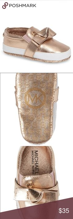 Michael Kors Crib Shoe 100% Authentic Baby crib shoes featured in a beautiful gold color with front bow tie and signature logos. Style your baby in the latest designer brand. MICHAEL Michael Kors Shoes Baby & Walker