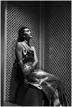"""photo George Hoyningen-Huene – Vogue described as """"mad about her Schiaparelli glass dress"""". Fabric by Colcombet,1930 ca A transparent Rhodophane tunic over pale blue satin worn by Madame Vittorio Crespi,"""