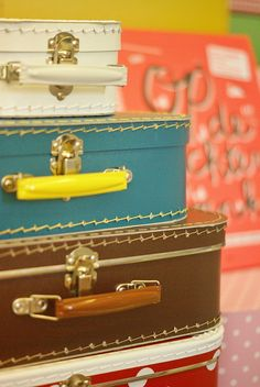 small suitcases by wood & wool stool, via Flickr