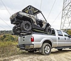 Camo Can-Am Commander on DiamondBack Side-by-Side Hauler. I would love to mod this so I can haul my sled on the back.