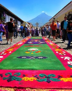 "Roll out the [colorful] carpet!  Traveling to Antigua Guatemala for Semana Santa was one of my biggest travel adventures. These bright beautiful carpets are hand-crafted out of colorful sawdust in preparation for parades of ""Roman"" soldiers reenacting Holy Week and they are continually reworked and remade as the parades move through town!  #NowThatsRewarding #TBAmarriott  @MarriottRewards @TheBlondeAbroad by janmargaret"