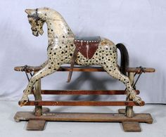"ANTIQUE WOOD CARVED ROCKING HORSE. GLASS EYES. LATE VICTORIAN OR EARLY EDWARDIAN POSSIBLY LINES CO. 36"" H X 44 1/4"" W X 17"" D.  (TK)"