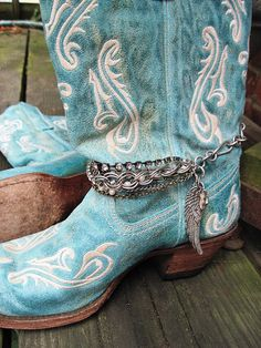 Cute cowgirl boots.  I could buy bigger charms at Hobby Lobby or use pendants I no longer wear & attach them to a metal belt & put them around a pair of boots.
