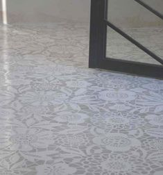 Love the lace stencil for a cement floor. Stencil from Royal Design Studio.
