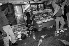 NYC protesters take to the streets in response to the acquittal of the officers involved in the beating of Rodney King. Some Asian-owned groceries such as this one were vandalized, April 1992.  Photo credit: Linda Rosier