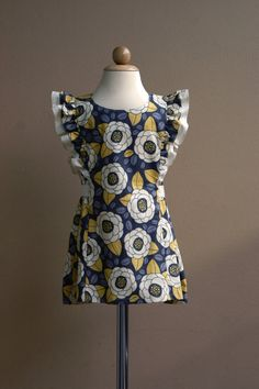 Pattern on Etsy!! Definitely making G a dress like this next summer!!! And I bet I could sell a few too :-)