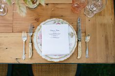 The vintage plates, flatware, and stemware decorated the long wood tables and were all provided by the Paramour Mansion.