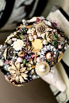 """I love this bouquet brooch - I can't imagine how much it would cost though.  Eek!  But I do believe something similar could be created in a """"costume jewelry"""" kind of way.  Yes? :)"""