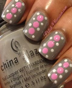 Base is China Glaze Recycle with  Nails Inc. Power Pink and Orly Au Champagne dots
