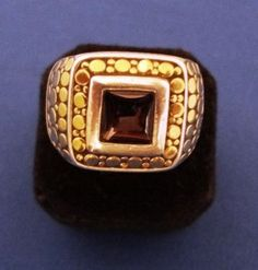 John Hardy Sterling Silver and 18k Gold ring with Garnet stone inlay.  Price: $420.00 http://www.theguildshop.org/john-hardy-sterling-silver18k-gold