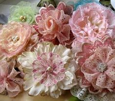 Flowers made by combining eyelet and lace ribbon with silk flowers that have been disassembled.
